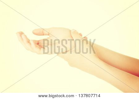 Woman holding her hand - pain concept