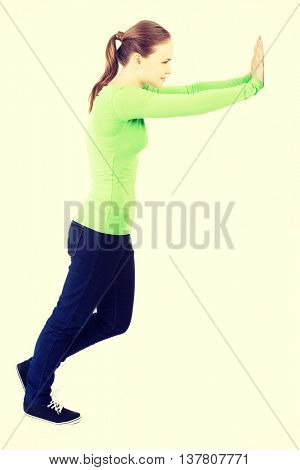 Woman pushing something imaginary