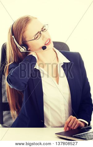Woman at call center is having back ache.