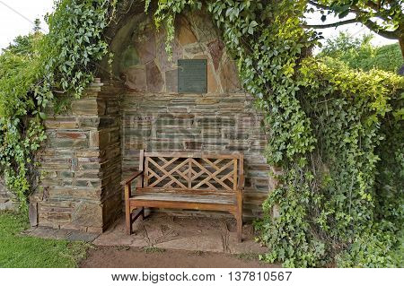 Romantic nook with wood bench and hedge for repose (people in love), South Africa