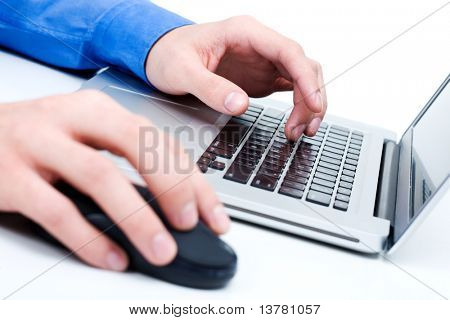 Close-up of male hands on mouse and over black keyboard of laptop during computer work