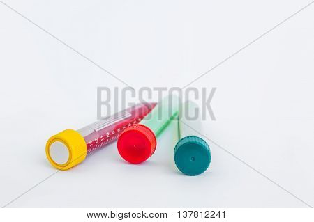 Test tube with fluid on gray background