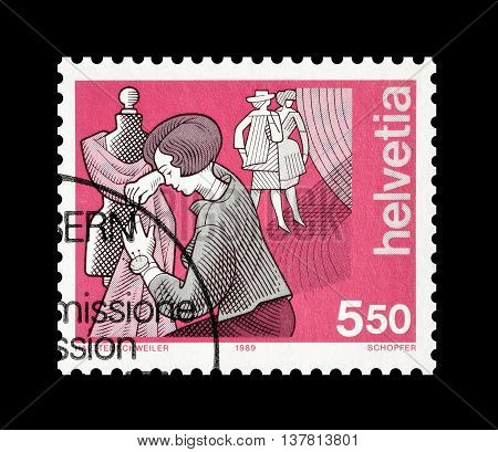 SWITZERLAND - CIRCA 1989 : Cancelled postage stamp printed by Switzerland, that shows Dressmaker.