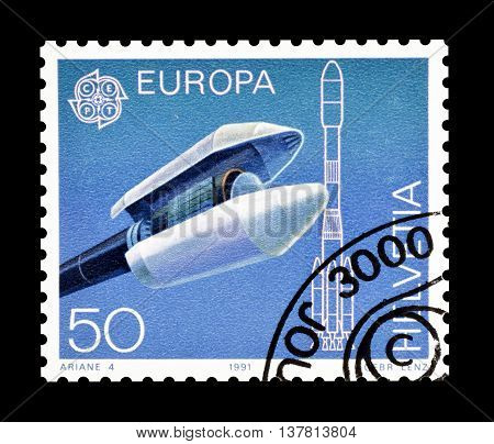 SWITZERLAND - CIRCA 1991 : Cancelled postage stamp printed by Switzerland, that shows Cargo load cladding of the carrier rocket Ariane 4.