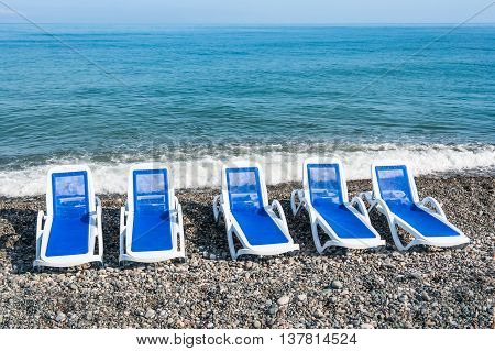 Sunbathing Blue Beds On The Beach