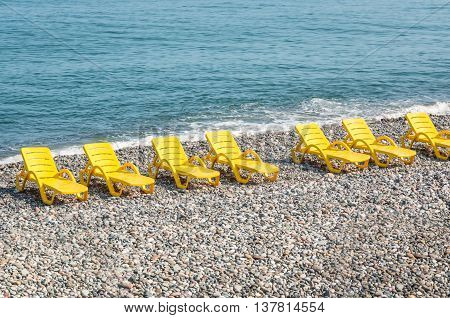Beach Yellow Chairs Or Beds On The Beach
