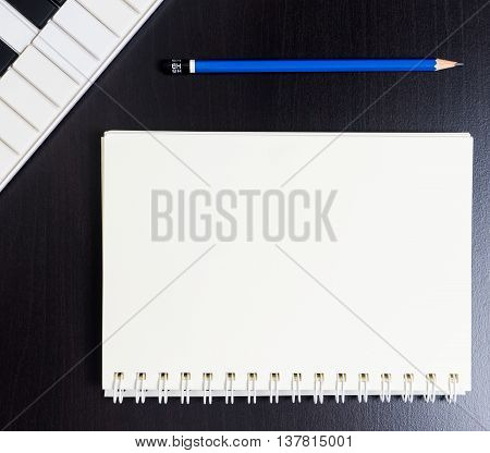Blank Binding book with Midi Keyboard for music writing.