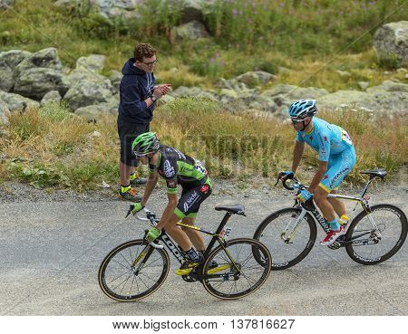 Col de la Croix de Fer France - 25 July 2015:The cyclists Anthony Delaplace of Bretagne-Seche Environnement Team and Lieuwe Westra of Astana Team climbing to the Col de la Croix de Fer in Alps during the stage 20 of Le Tour de France 2015.