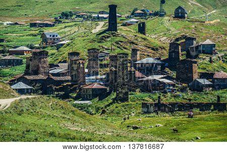 Ushguli Georgia - July 24 2015. Characteristic for the entire Svaneti region stone defensive towers in small village Chazhashi part of Ushguli community in Svaneti region