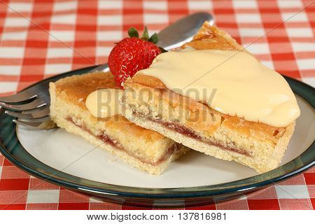 two slices of fresh bakewell pudding with a custard topping