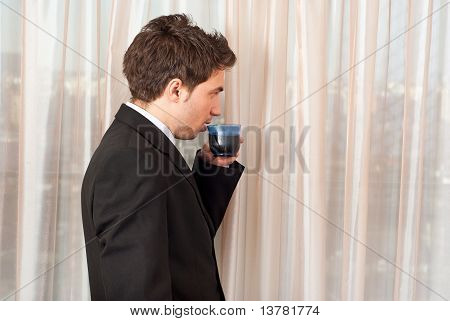 Business Man Drinking Cofffee