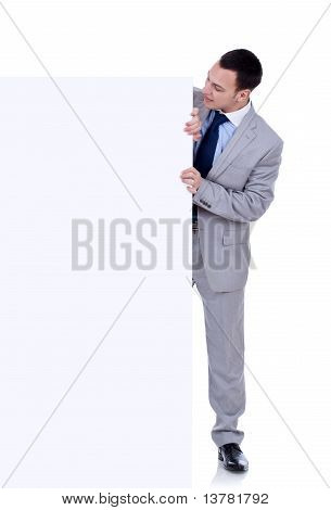 Man Peeking Behind Empty Board
