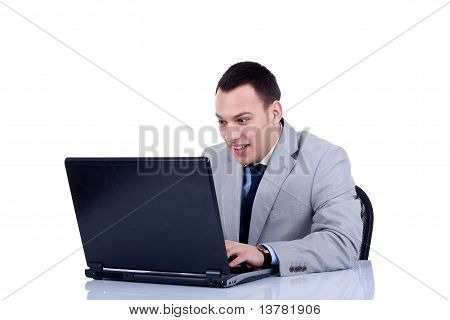 Amased Business Man At His Laptop