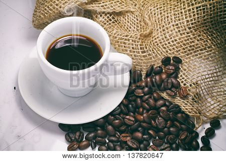 black coffee beans on white background .