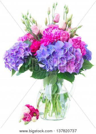 Bright pink peony, eustoma and blue hortensia flowers bouquet isolated on white background