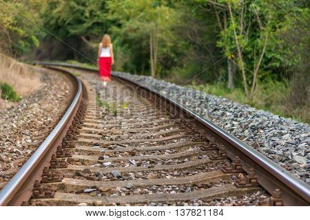 Young Lady Walking On Railway Tracks