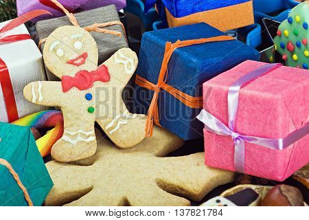 smiling gingerbread man and Christmas decorations for the holiday