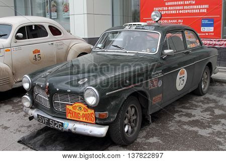 PERM RUSSIA - JUNE 29 2016: Rally of retro-cars Peking-Paris 2016 June 29 2016 in Perm Russia. Cars participating in the rally are near the hotel.