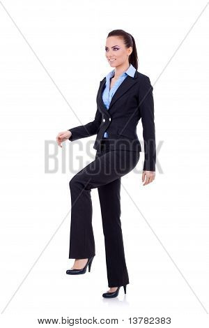 Business Woman Stepping On Imaginary Step