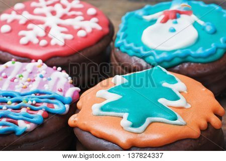 Christmas gingerbread coated with chocolate icing and colorful