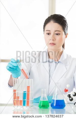 Beautiful Asian Female Biologist Working On Chemicals