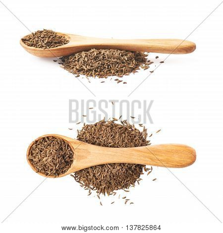 Wooden spoon over the pile of cumin seeds isolated over the white background, set of two different foreshortenings