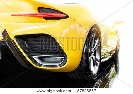 Back of a yellow modern sport car in sunset