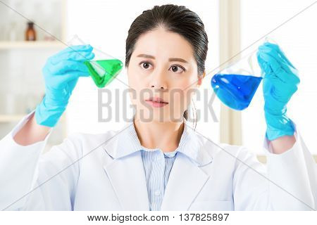 Asian Female Scientist Researcher Observing Indicator Color Shift