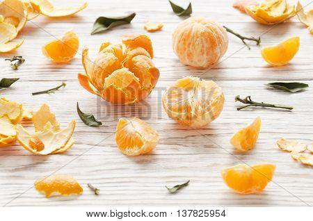 Tangerines on white wooden background. Still life.