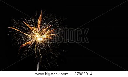 Abstract pyrotechnic glowing explosion on black background. fireworks landscape. Golden flash. Festival card design template.