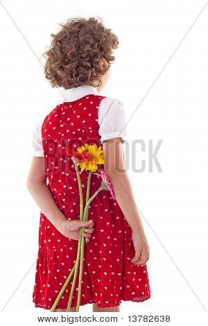Back Of Little Girl Hiding Flowers For Mother's Day