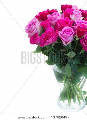 bouquet of pink and magenta fresh roses in vase close up isolated on white background