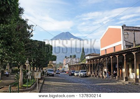 ANTIGUA GUATEMALA - OCTOBER 02 2015: Market in the central square of Antigua Guatemala on the background of volcano