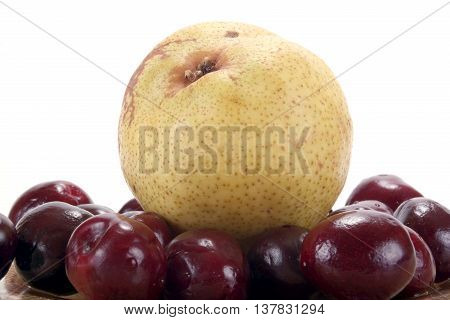 Pear and ripe berries are isolated on a white background