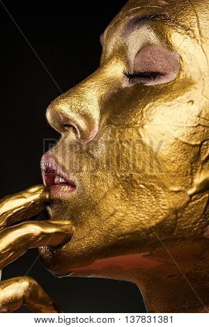 Profile Of A Beautiful Woman With Yellow Streaks Of Paint On His Face