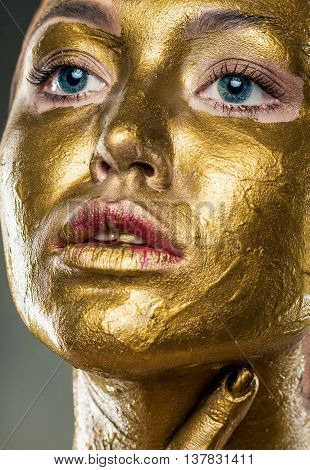 Art Wear Make Up. Fashion Make-up With Yellow Paint. Portrait Of A Woman On A Gray Background