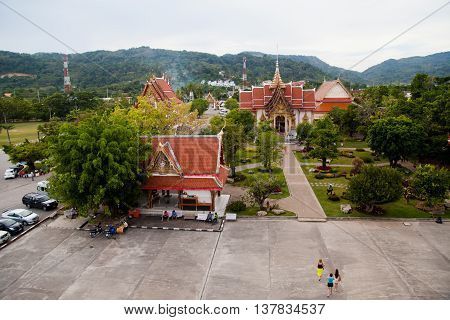 Phuket, Thailand - December 21 : temple Wat Chalong built in 1809-1824 , the view from the observation deck on large property with lawns and pools on the Day of St. Lucia, December 21, 2012.