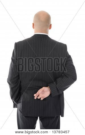 businessman with crossed fingers at back