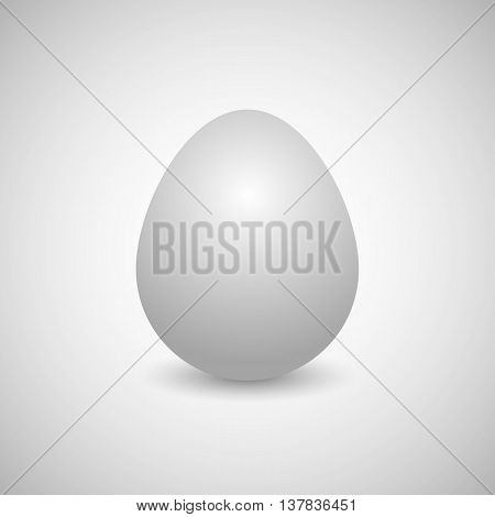 Icon white egg isolated on a gray background vertically disposed with shadow vector illustration.