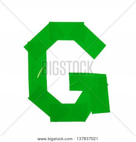 Letter G symbol made of insulating tape pieces, isolated over the white background