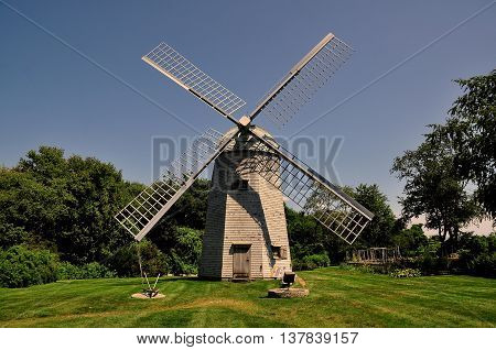 Middletown Rhode Island - July 16 2015: 1812 Robert Sherman shingled smock windmill at the Prescott Farm historic site
