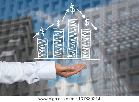 Drawing graphics growing graph on hand to concept of investment profit in business and have skyscraper background.