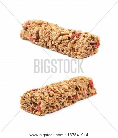 Nutrient chewy grains bar isolated over the white background, set of two foreshortenings