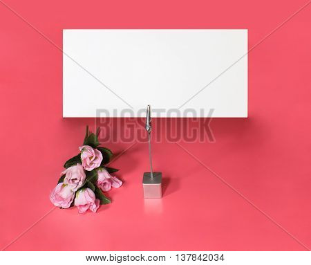 A note holder with a roses and a empty card for your text