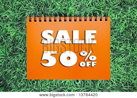50% Sale Sign On Grass Background