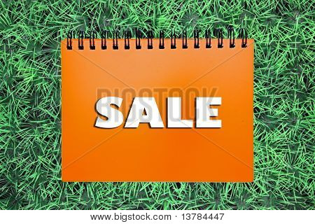 Sale Sign On Grass Background