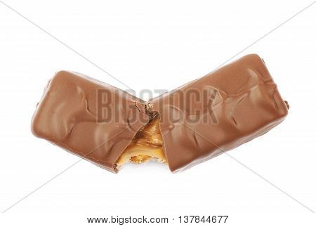 Caramel chocolate bar isolated over the white background