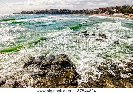 SOZOPOL - AUGUST 9: Old City  embankment on August 9, 2015 in Sozopol, ancient city on a rocky promontory of the peninsula near the sea. sea ​​with small waves and a trace of water bike