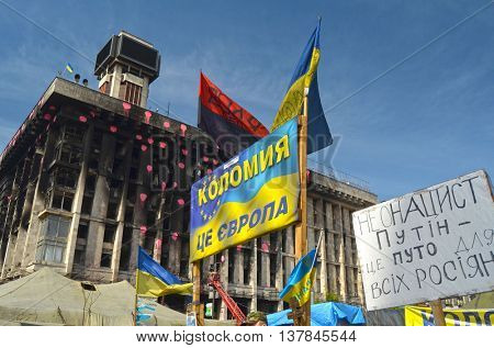 KIEV, UKRAINE -MAR 17, 2014: Poster - Kolomyia is Europe (Ukrainian).Downtown of Kiev.Burnt down the House of trade unions Riot in Kiev .March 17, 2014 Kiev, Ukraine