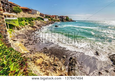 SOZOPOL - AUGUST 9: Old City beach on August 9 2015 in Sozopol Bulgaria. Waves running on to the beach of ancient Bulgarian city Sozopol in the mornig